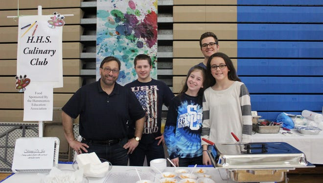 (From left to right) Chef Lou Caruso, teacher of Culinary Arts at Hammonton High School, stands with members Daniel Dorfman, Jonathan Swayne and Danielle McManus. McManus's friend Hannah Bailey (far right), who is not a member of the Culinary Club, decided to come help her friend during Taste of the Town