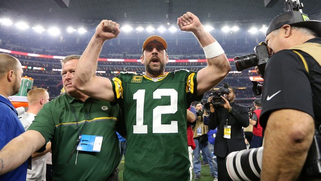 Green Bay Packers quarterback Aaron Rodgers (12) celebrate after beating the Dallas Cowboys in the NFC Divisional playoff game at AT&T Stadium.