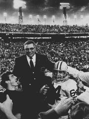 Vince Lombardi is carried off after coaching the Packers to a win in Super Bowl II, giving Green Bay back-to-back titles.