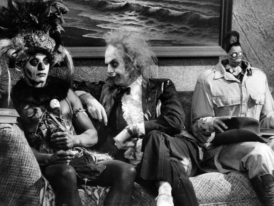 "In 1988's ""Beetlejuice,"" Michael Keaton (center) plays"