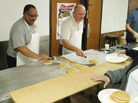 Kenny Anderson Jr. serves breakfast at the American Legion Pancake Feed to benefit youth programming in Sioux Falls.