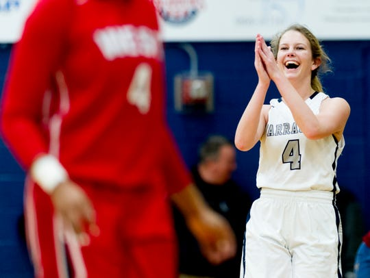 Claire Wyatt (4) celebrates the win Farragut's during