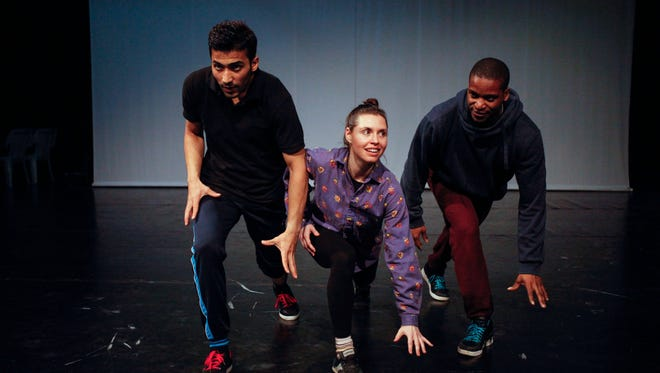 In this Saturday, April 18, 2015 photo, Adil Faraj, left, and his two dance mentors Sean Scantlebury, right, and  Mira Cook rehearse at the National Centre for Culture and Arts in Amman, Jordan, after training together over Skype for six months. Faraj taught himself dance in the chaos of post-2003 Iraq, facing public discrimination, police brutality and social stigma. He was discovered by the Manhattan-based Battery Dance Company and brought to Jordan to train professionally and perform for the first time on a stage. (AP Photo/Sam McNeil)