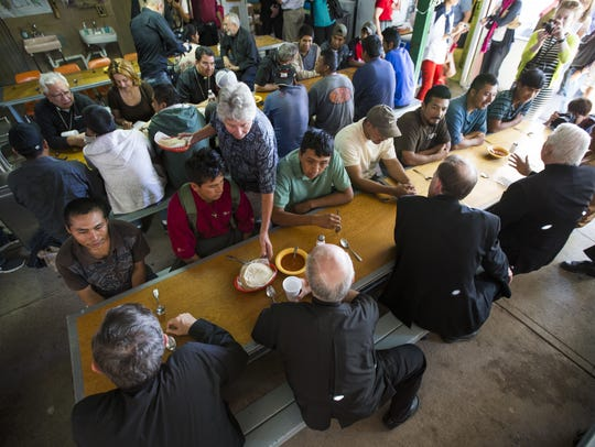 Migrants talk with Catholic bishops at the Kino Border