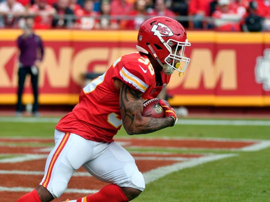 Kansas City Chiefs running back Charcandrick West (35) carries a punt return during the first half of an NFL football game against the Buffalo Bills in Kansas City, Mo., Sunday, Nov. 26, 2017.