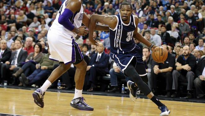 Oklahoma City Thunder forward Kevin Durant drives in against Sacramento Kings forward Jason Thompson during the second quarter at Sleep Train Arena.