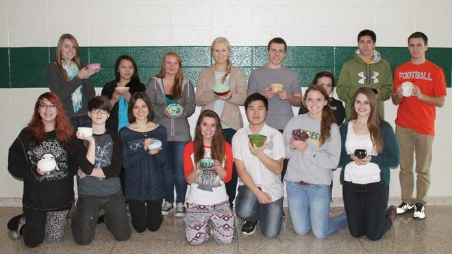 Students from the DCE Art Explorations 3D class show their handcrafted bowls for the Empty Bowl event.