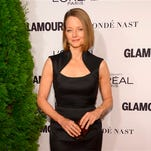"In this file photo, Jodie Foster arrives at the 2014 Glamour Women of the Year Awards, hosted by L'Oreal Paris, at Carnegie Hall in New York. Foster is up for a pair of awards for directing comedy and drama on television. The Directors Guild of America announced TV nominees Wednesday for its annual honors, and Foster's name was called twice: in the drama series category for an episode of ""House of Cards,"" and in the comedy series category for an installment of ""Orange is the New Black."""
