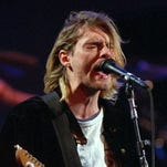 This 1993 file photo shows Kurt Cobain of the Seattle band Nirvana performing in Seattle, Wash. It's been two decades since the Nirvana frontman took his own life yet he remains on in the thoughts of those he influenced and entertained.