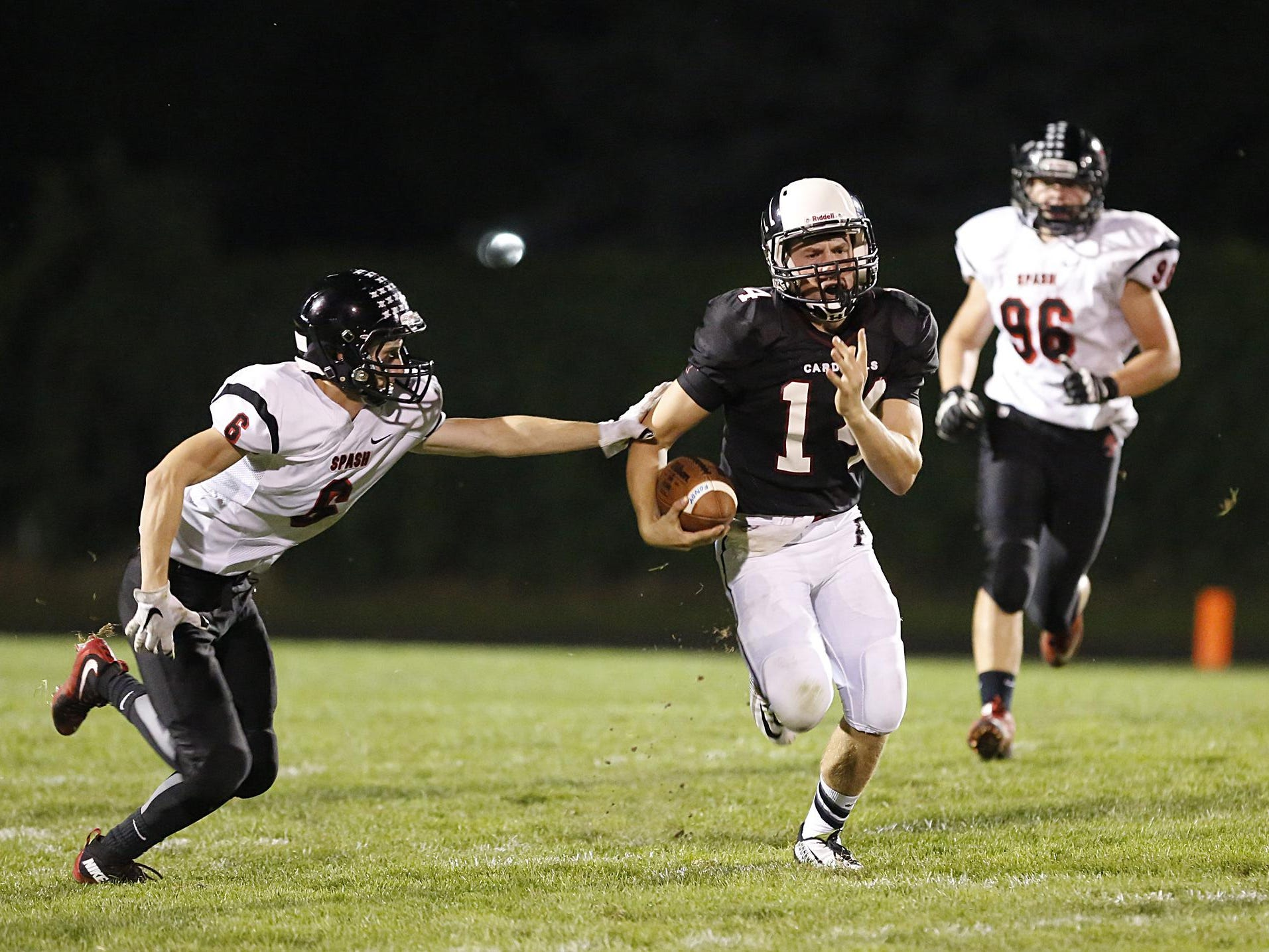 Fondy's Quinn Woelfel runs past a SPASH defender Friday night.