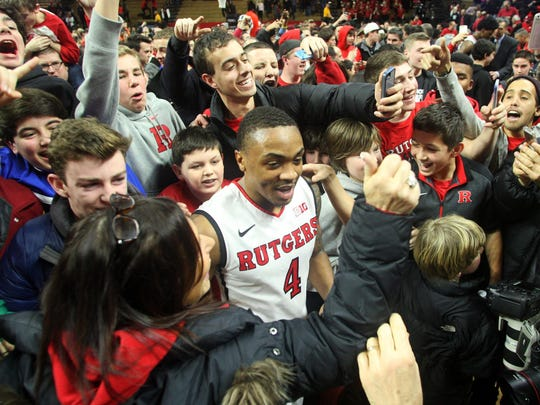Then-Rutgers men's basketball star Myles Mack was swarmed by students and fans after an upset of No. 4-ranked Wisconsin in January 2015.