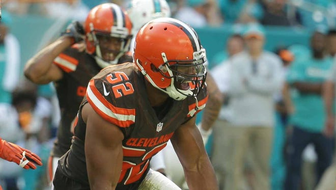 Cleveland Browns linebacker Corey Lemonier celebrates after recovering a fumble by  Miami Dolphins quarterback Ryan Tannehill during overtime Sept. 25, 2016, in Miami Gardens, Fla.