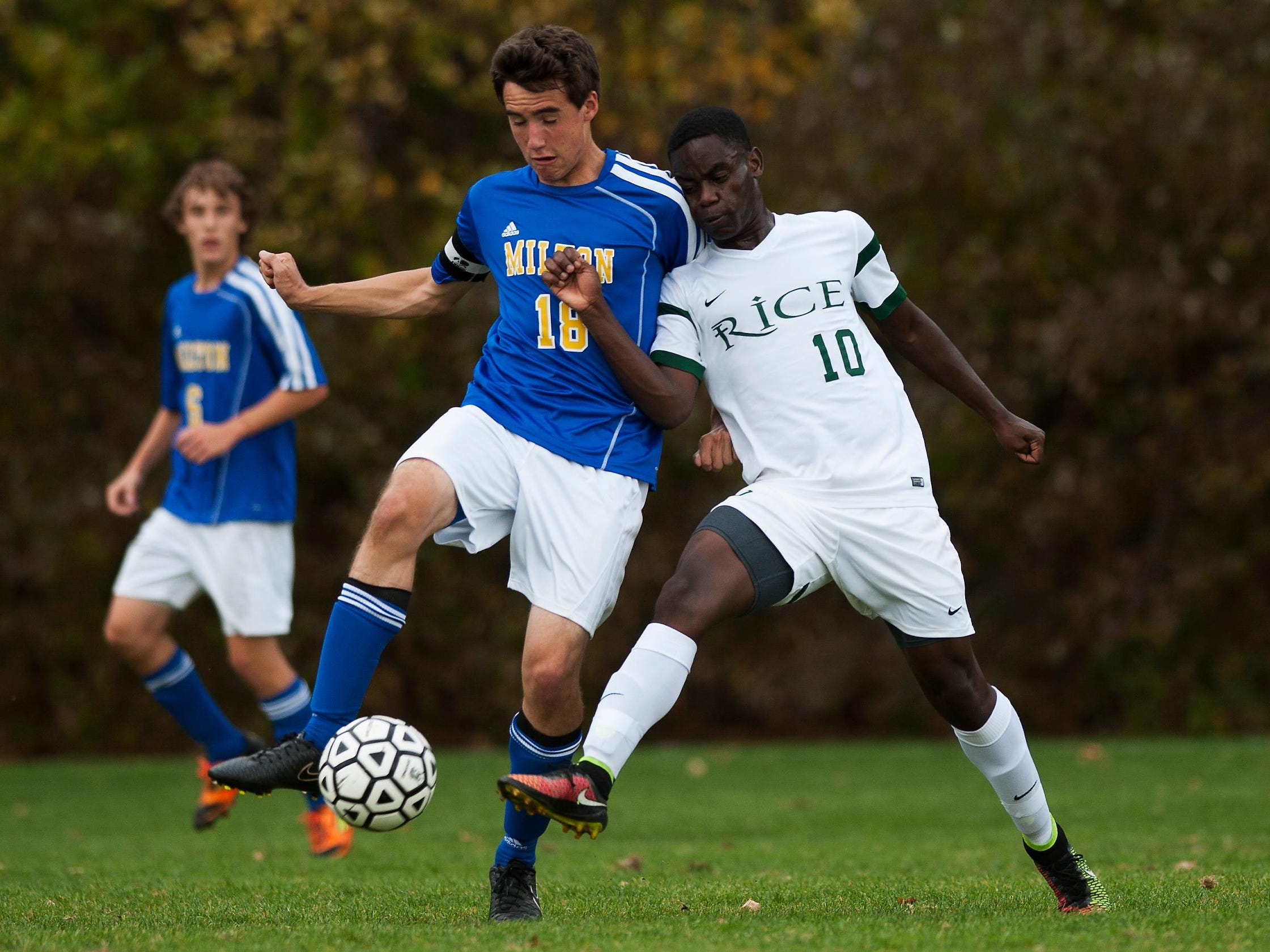 Rice's Hussein Hussein (10) battles for the ball with Milton's Eric Menard (18) during the boys varsity soccer game between the Milton Yellow Jackets and the Rice Green Knights at Rice High School on Wednesday October 15, 2014 in South Burlington, Vermont. (BRIAN JENKINS, for the Free Press)
