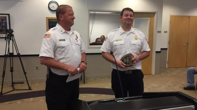 City of Pekin Fire Chief Kurt Nelson (left) presents the 2019 Firefighter of the Year award to Deputy Chief Trent Reese during Tuesday's City Council Meeting.