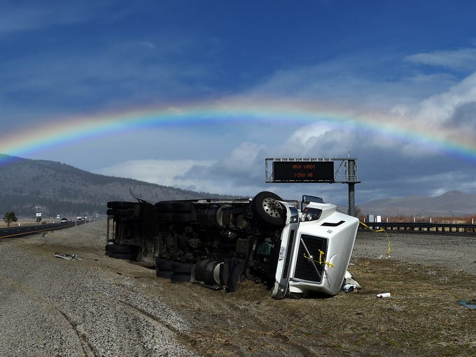 A truck traveling south on highway 395 is seen after