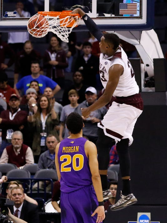 Texas A&M guard Danuel House (23) goes up for a dunk as Northern Iowa guard Jeremy Morgan (20) looks on in the second half during a second-round men's college basketball game in the NCAA Tournament in Oklahoma City, Sunday, March 20, 2016. Texas A&M won in double overtime 92-88. (AP Photo/Alonzo Adams)