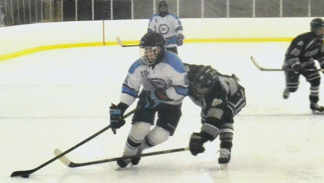 Suffern defenseman Troy Daniels pushes into the zone Friday during a 2-0 win over Shenendehowa.