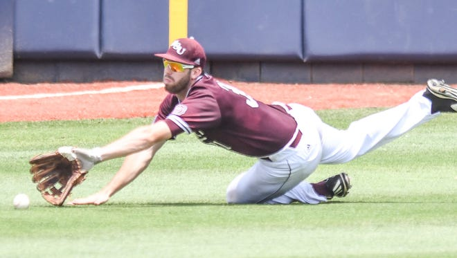 Missouri State outfielder Landan Ruff (31) dives for a ball that falls for a single by Tennessee Tech infielder John Ham (3) in the NCAA Oxford Regional, at Oxford-University Stadium in Oxford, Miss. on Saturday, June 2, 2018. (Bruce Newman, Oxford Eagle via AP)