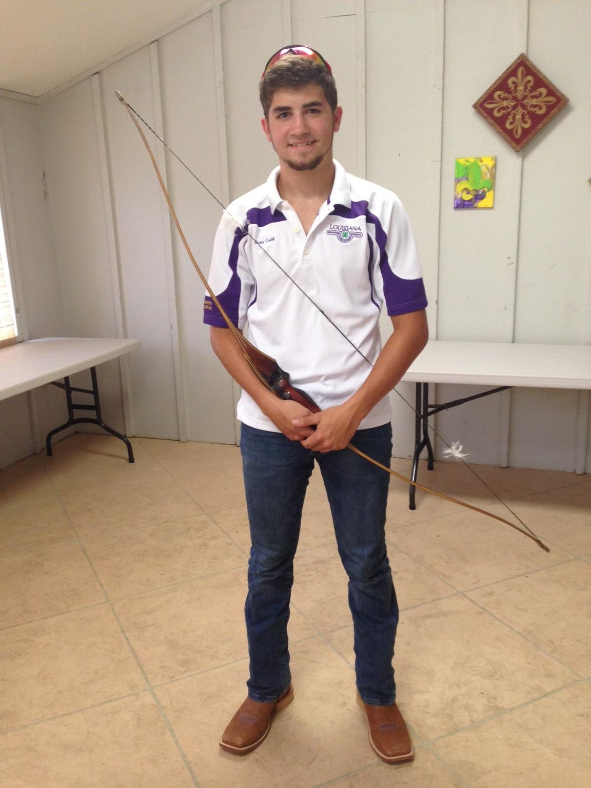 Sean Craig Jr. poses with his self-made English longbow