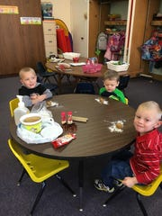 "The St. Mary Elementary School preschool class enjoyed exploring gingerbread. They read Jan Brett's ""The Gingerbread Baby"" and finger painted a gingerbread house. They also acted out the traditional gingerbread man story, then made gingerbread cookies. Pictured are Zac Lemke, from left, Bentley Davis and Johnathan Olson."