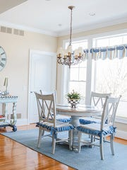 The chair cushions, done by Ambiance, and the Dash & Albert rug are made of sturdy fabric to stand up to the Randalls' five grandchildren.