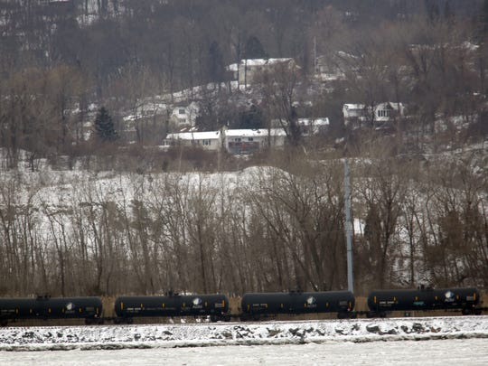 A train pulling tanker cars used for crude oil passes through Tomkins Cove on Jan. 27, 2014. ( Ricky Flores / The Journal News )