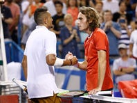 FILE - In this Aug. 3, 2019, file photo, Nick Kyrgios, left, of Australia, and Stefanos Tsitsipas, of Greece, meet at the net after Kyrgios defeated Tsitsipas in a semifinal at the Citi Open tennis tournament in Washington. Tsitsipas sent his tennis mate Kyrgios a special 25th birthday greeting. (AP Photo/Patrick Semansky, File)