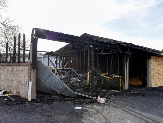 An eight-stall garage unit was heavily damaged by fire