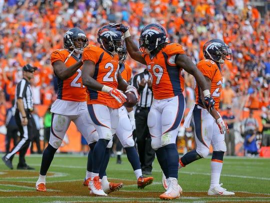 Broncos defensive back Darian Stewart (26) celebrates