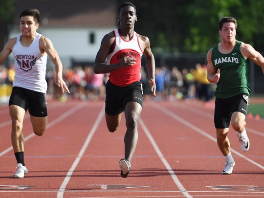 Boys and girls track and field championship at River Dell High School on Friday, May 26, 2017. (center) Quazier Dailey, of Manchester, competes in the 100M.