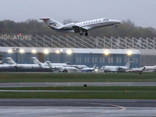 A jet takes off at the Westchester County Airport in