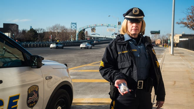 Sergeant Allison Mankoski holds a dose of Narcan at the Ben Franklin Bridge on Thursday, December 21.