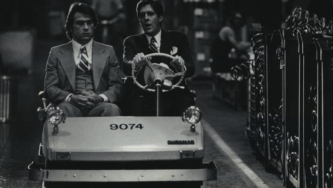 "Edward Herrmann (right) shows Tommy Lee Jones around an automobile assembly plant during the filming of a scene of ""The Betsy"" in American Motors' automobile assembly plant in Kenosha on Sept. 20, 1977. This photo was published in the Sept. 21, 1977, Milwaukee Sentinel."