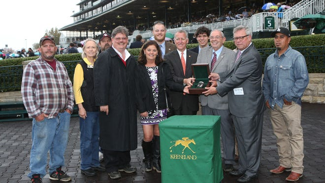 Ken Ramsey accepts his 16th leading owner title at Keeneland.