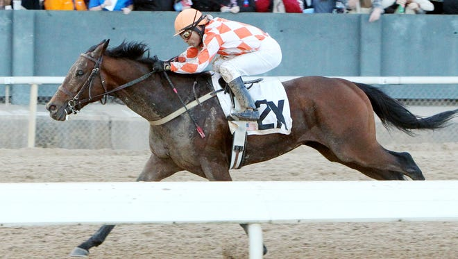 Suddenbreakingnews ran late to win Monday's Southwest Stakes at Oaklawn Park.