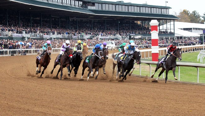 Riker, right, leads in the early going of the Breeders' Cup Juvenile at Keeneland.
