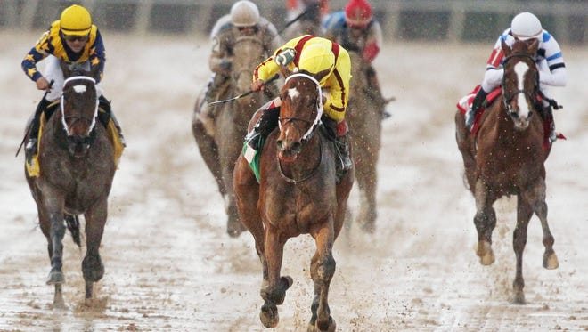 Terra Promessa stormed down the center of the track Saturday to win the Grade III Honeybee at Oaklawn.
