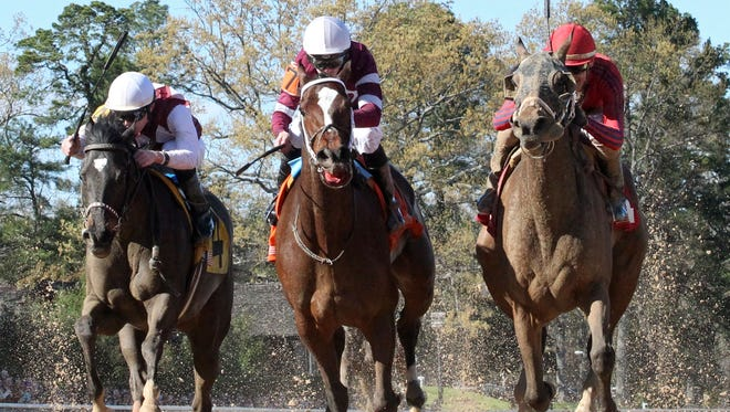 Call Pat, right, race by Untapable late for a win in Oaklawn Park's Azeri Stakes.