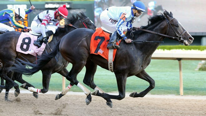 Upstart made a major move in the turn of Saturday's Razorback Handicap, going on to win in his return.