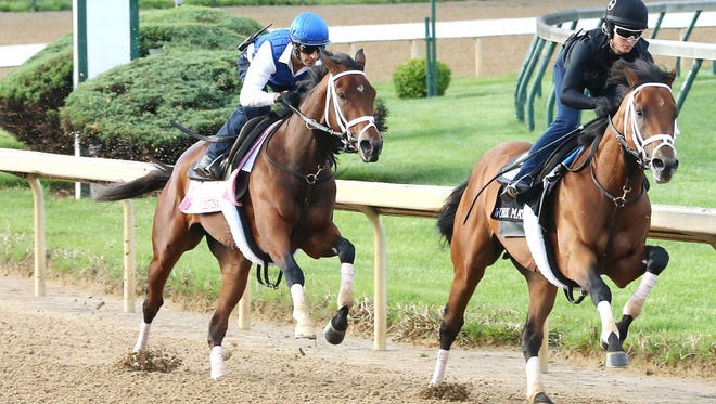 Rachel's Valentina, left, passed her workmate in Thursday's drill at Churchill Downs.
