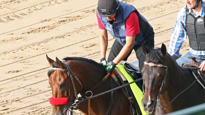 Nyquist, left, jogged Sunday for the first time at Churchill Downs.