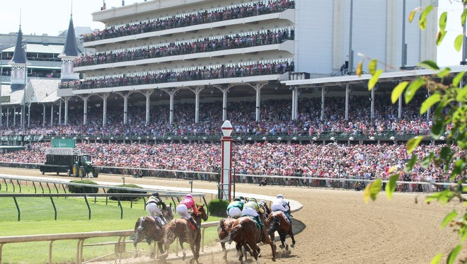 A record crowd packed Churchill Downs for Friday's Kentucky Oaks.