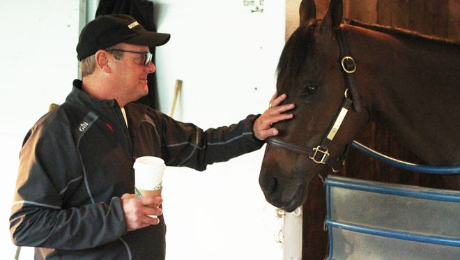 Trainer John Servis with Cathryn Sophia the morning after the Kentucky Oaks.