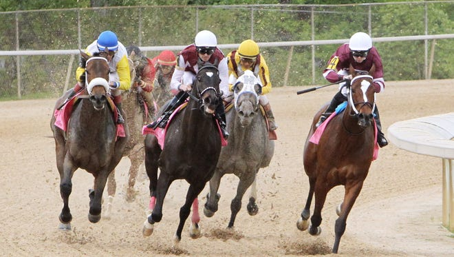 Untapable, right, showed early speed in her last start, the Apple Blossom at Oaklawn Park.