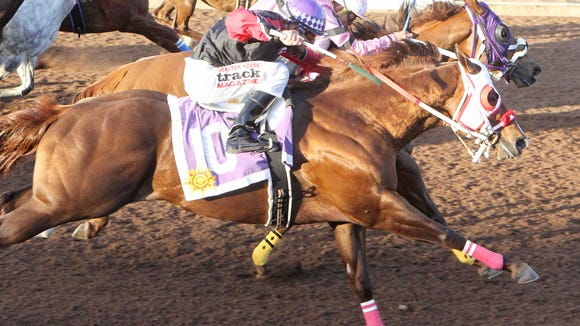 Seis Menudos won the featured stakes race Saturday at Sunland Park Racetrack & Casino