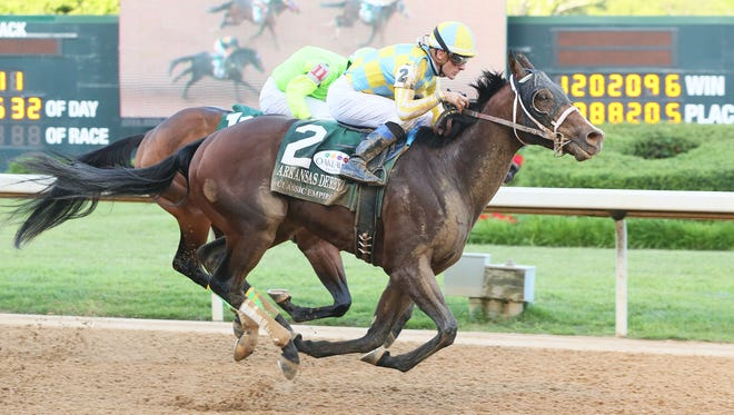 Classic Empire and jockey Julien Leparoux win Saturday's Arkansas Derby at Oaklawn Park.