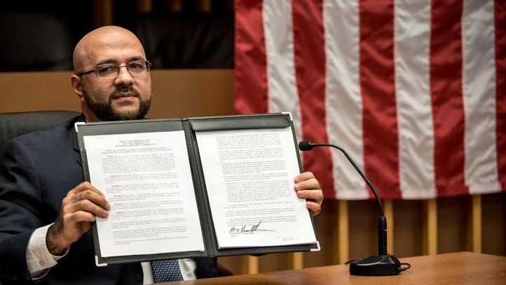 Mayor Mohamed T. Khairullah with his executive order.