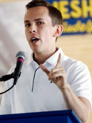 Mississippi Republican State Auditor Shad White speaks about the cost saving measures affecting his agency's budget request to the Legislature, Wednesday, Aug. 1, 2018, at one of the biggest political events of the year in the state, the Neshoba County Fair, in Philadelphia, Miss., Aug. 1, 2018.