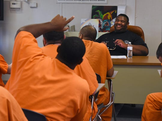 William Calhoun smiles while interacting with inmates attending the Steve Hoyle Intensive Substance Abuse treatment program