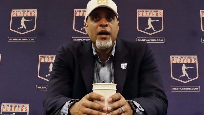 Tony Clark, executive director of the Major League Players Association, answers questions at a news conference in Phoenix in 2017. Clark's players union executive board on Monday rejected a proposed 60-game schedule for the 2020 regular season, after which owners decided to go forward with the shortest schedule since 1878.